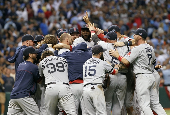 Oct 8, 2013; St. Petersburg, FL, USA; Boston Red Sox designated hitter David Ortiz (34) hug and celebrate with teammates after they beat the Tampa Bay Rays in game four of the American League divisional series at Tropicana Field. Boston Red Sox defeated theTampa Bay Rays 3-1. Mandatory Credit: Kim Klement-USA TODAY Sports