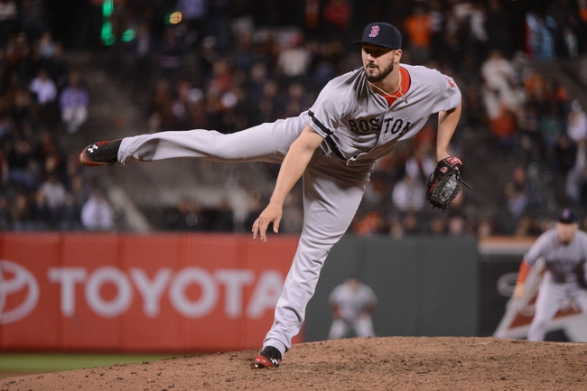 August 19, 2013; San Francisco, CA, USA; Boston Red Sox relief pitcher Brandon Workman (67) delivers a pitch during the seventh inning against the San Francisco Giants at AT&T Park. The Red Sox defeated the Giants 7-0. Mandatory Credit: Kyle Terada-USA TODAY Sports