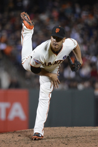 August 19, 2013; San Francisco, CA, USA; San Francisco Giants relief pitcher Guillermo Moscoso (34) delivers a pitch during the seventh inning against the Boston Red Sox at AT&T Park. The Red Sox defeated the Giants 7-0. Mandatory Credit: Kyle Terada-USA TODAY Sports