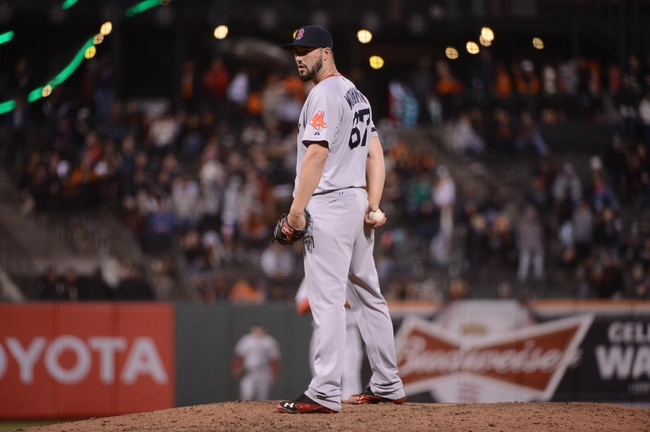 August 19, 2013; San Francisco, CA, USA; Boston Red Sox relief pitcher Brandon Workman (67) prepares to deliver a pitch during the seventh inning against the San Francisco Giants at AT&T Park. The Red Sox defeated the Giants 7-0. Mandatory Credit: Kyle Terada-USA TODAY Sports