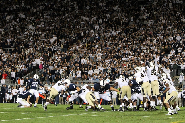 Sep 14, 2013; University Park, PA, USA; Penn State Nittany Lions punt kicker Sam Ficken (97) attempts a field goal during the fourth quarter against the Central Florida Knights at Beaver Stadium. Mandatory Credit: Matthew O'Haren-USA TODAY Sports