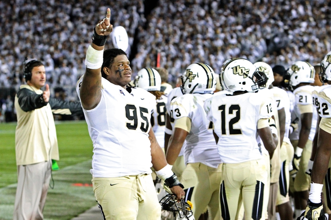 Sep 14, 2013; University Park, PA, USA; Central Florida Knights defensive linesmen E.J. Dunston (95) signals to the fans during the fourth quarter against the Penn State Nittany Lions at Beaver Stadium. Mandatory Credit: Matthew O'Haren-USA TODAY Sports