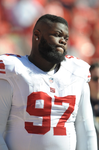 Sep 29, 2013; Kansas City, MO, USA; New York Giants defensive tackle Linval Joseph (97) watches play during the second half of the game against the Kansas City Chiefs at Arrowhead Stadium. The Chiefs won 31-7. Mandatory Credit: Denny Medley-USA TODAY Sports