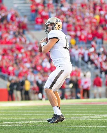 Sep 21, 2013; Madison, WI, USA;  Purdue Boilermakers quarterback Rob Henry (15) during the game against the Wisconsin Badgers at Camp Randall Stadium. Wisconsin defeated Purdue 41-10.  Mandatory Credit: Jeff Hanisch-USA TODAY Sports