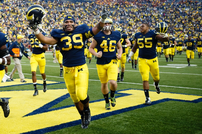 Oct 5, 2013; Ann Arbor, MI, USA; Michigan Wolverines fullback Sione Houma (39) celebrate after the game against the Minnesota Golden Gophers at Michigan Stadium. Michigan won 42-13. Mandatory Credit: Rick Osentoski-USA TODAY Sports