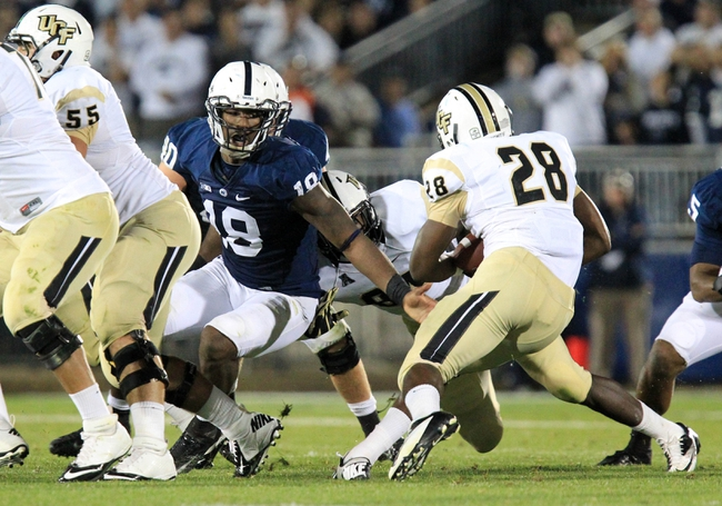 Sep 14, 2013; University Park, PA, USA; Penn State Nittany Lions defensive end Deion Barnes (18) attempts to stop Central Florida Knights running back William Stanback (28) during the fourth quarter at Beaver Stadium. Mandatory Credit: Matthew O'Haren-USA TODAY Sports