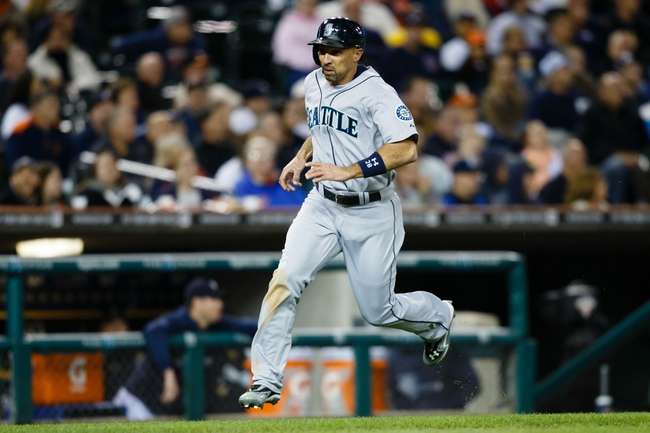 Sep 16, 2013; Detroit, MI, USA; Seattle Mariners left fielder Raul Ibanez (28) scores a run against the Detroit Tigers at Comerica Park. Mandatory Credit: Rick Osentoski-USA TODAY Sports