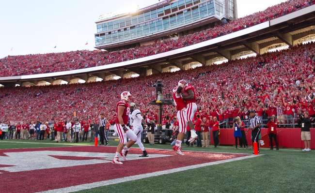 Sep 21, 2013; Madison, WI, USA;  The Wisconsin Badgers celebrate a touchdown during the game against the Purdue Boilermakers at Camp Randall Stadium. Wisconsin defeated Purdue 41-10.  Mandatory Credit: Jeff Hanisch-USA TODAY Sports