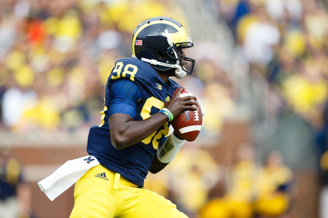 Oct 5, 2013; Ann Arbor, MI, USA; Michigan Wolverines quarterback Devin Gardner (98) looks to pass against the Minnesota Golden Gophers at Michigan Stadium. Mandatory Credit: Rick Osentoski-USA TODAY Sports