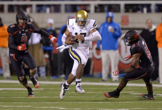 Oct 3, 2013; Salt Lake City, UT, USA; UCLA Bruins quarterback Brett Hundley (17) is pursued by Utah Utes linebacker Trevor Reilly (9) and safety Eric Rowe (18) on a 36-yard touchdown run in the fourth quarter at Rice-Eccles Stadium. UCLA defeated Utah 34-27. Mandatory Credit: Kirby Lee-USA TODAY Sports