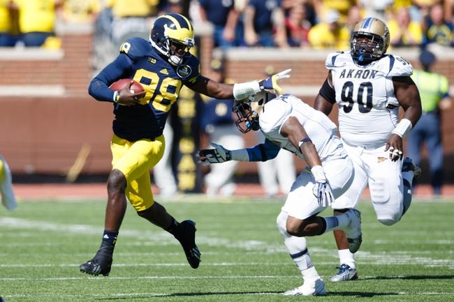Sep 14, 2013; Ann Arbor, MI, USA; Michigan Wolverines quarterback Devin Gardner (98) runs the ball against the Akron Zips at Michigan Stadium. Mandatory Credit: Rick Osentoski-USA TODAY Sports