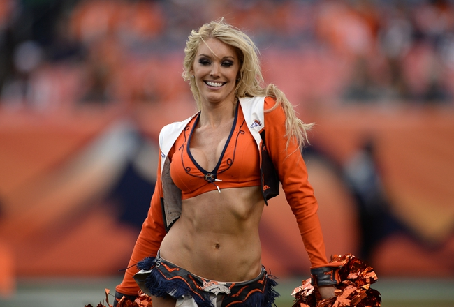 Sep 29, 2013; Denver, CO, USA; Denver Broncos cheerleader performs during the game against the Philadelphia Eagles at Sports Authority Field at Mile High. The Broncos defeated the Eagles 52-20. Mandatory Credit: Ron Chenoy-USA TODAY Sportsf