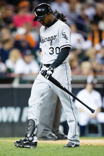 Sep 21, 2013; Detroit, MI, USA; Chicago White Sox left fielder Alejandro De Aza (30) walks back to the dugout after striking out against the Detroit Tigers at Comerica Park. Mandatory Credit: Rick Osentoski-USA TODAY Sports