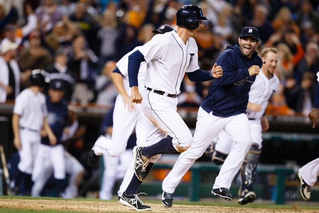 Sep 21, 2013; Detroit, MI, USA; Detroit Tigers left fielder Don Kelly (32) and catcher Alex Avila (13) celebrate after the game against the Chicago White Sox at Comerica Park. Mandatory Credit: Rick Osentoski-USA TODAY Sports