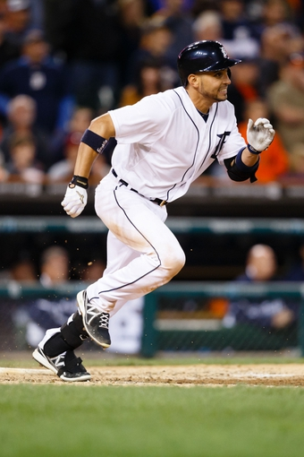 Sep 21, 2013; Detroit, MI, USA; Detroit Tigers second baseman Omar Infante (4) runs to first against the Chicago White Sox at Comerica Park. Mandatory Credit: Rick Osentoski-USA TODAY Sports