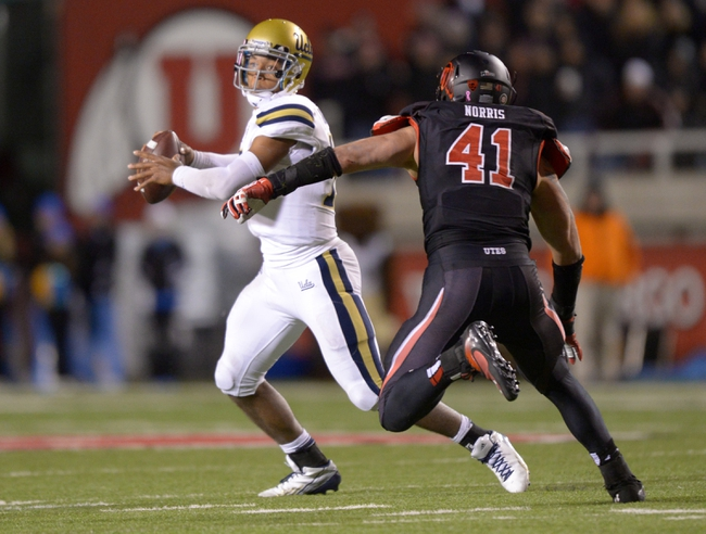 Oct 3, 2013; Salt Lake City, UT, USA; UCLA Bruins quarterback Brett Hundley (17) is pressured by Utah Utes linebacker Jared Norris (41) at Rice-Eccles Stadium. UCLA defeated Utah 34-27. Mandatory Credit: Kirby Lee-USA TODAY Sports