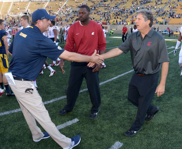 Oct 5, 2013; Berkeley, CA, USA; California Golden Bears coach Sonny Dykes (left) and Washington State Cougars coach Mike Leach shake hands after the game at Memorial Stadium. Washington State defeated California 44-22. Mandatory Credit: Kirby Lee-USA TODAY Sports