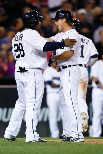 Sep 21, 2013; Detroit, MI, USA; Detroit Tigers left fielder Andy Dirks (12) is congratulated by first baseman Prince Fielder (28) after he hit a three run home run in the ninth inning against the Chicago White Sox at Comerica Park. Detroit won 7-6 in twelve innings. Mandatory Credit: Rick Osentoski-USA TODAY Sports