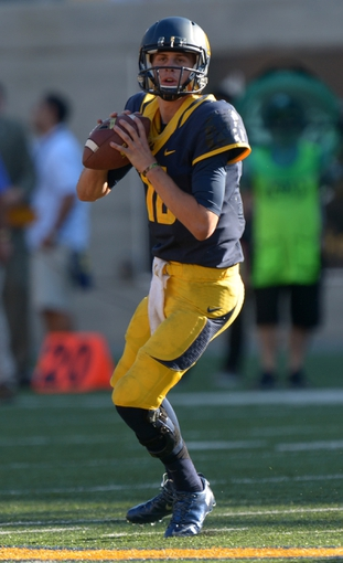 Oct 5, 2013; Berkeley, CA, USA; California Golden Bears quarterback Jared Goff (16) throws a pass against the Washington State Cougars at Memorial Stadium. Washington State defeated California 44-22. Mandatory Credit: Kirby Lee-USA TODAY Sports