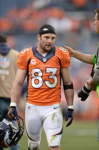 Sep 29, 2013; Denver, CO, USA; Denver Broncos wide receiver Wes Welker (83) leaves the field following the win over the Philadelphia Eagles at Sports Authority Field at Mile High. The Broncos defeated the Eagles 52-20. Mandatory Credit: Ron Chenoy-USA TODAY Sports