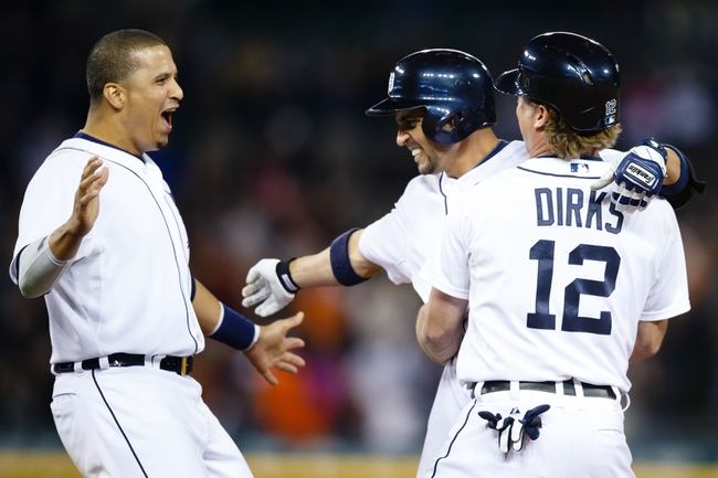 Sep 21, 2013; Detroit, MI, USA; Detroit Tigers left fielder Andy Dirks (12) second baseman Omar Infante (center) and designated hitter Victor Martinez (left) celebrates after Infante hit a game winning walkoff RBI single in the twelfth inning against the Chicago White Sox at Comerica Park. Detroit won 7-6. Mandatory Credit: Rick Osentoski-USA TODAY Sports