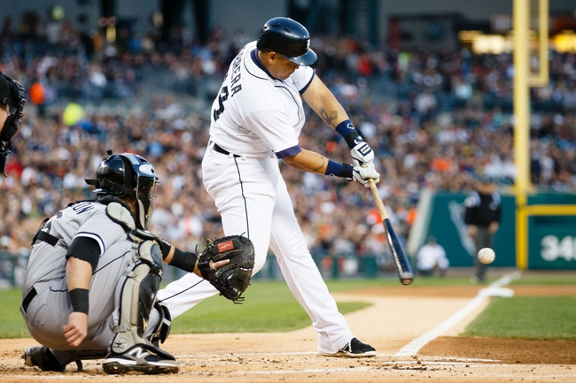 Sep 21, 2013; Detroit, MI, USA; Detroit Tigers third baseman Miguel Cabrera (24) at bat against the Chicago White Sox at Comerica Park. Mandatory Credit: Rick Osentoski-USA TODAY Sports