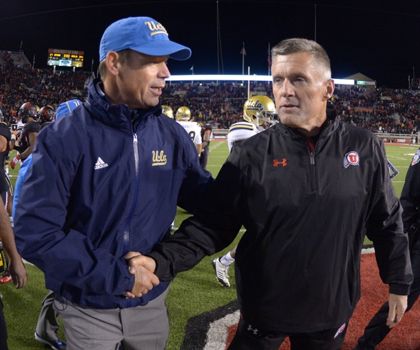 Oct 3, 2013; Salt Lake City, UT, USA; UCLA Bruins coach Jim Mora (left) shakes hands with Utah Utes coach Kyle Whittingham after the game at Rice-Eccles Stadium. UCLA defeated Utah 34-27. Mandatory Credit: Kirby Lee-USA TODAY Sports