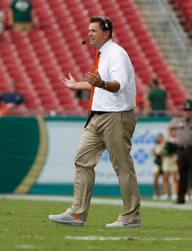 Sep 28, 2013; Tampa, FL, USA; Miami Hurricanes head coach Al Golden reacts against the South Florida Bulls during the second half at Raymond James Stadium. Miami Hurricanes defeated the South Florida Bulls 49-21. Mandatory Credit: Kim Klement-USA TODAY Sports