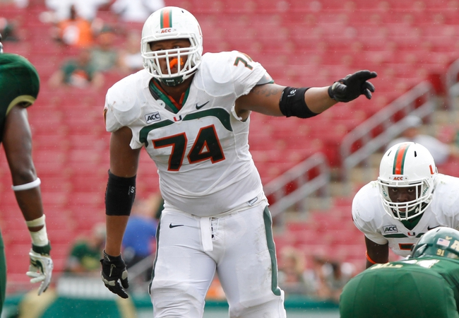 Sep 28, 2013; Tampa, FL, USA; Miami Hurricanes offensive linesman Ereck Flowers (74) against the South Florida Bulls during the second half at Raymond James Stadium. Miami Hurricanes defeated the South Florida Bulls 49-21. Mandatory Credit: Kim Klement-USA TODAY Sports
