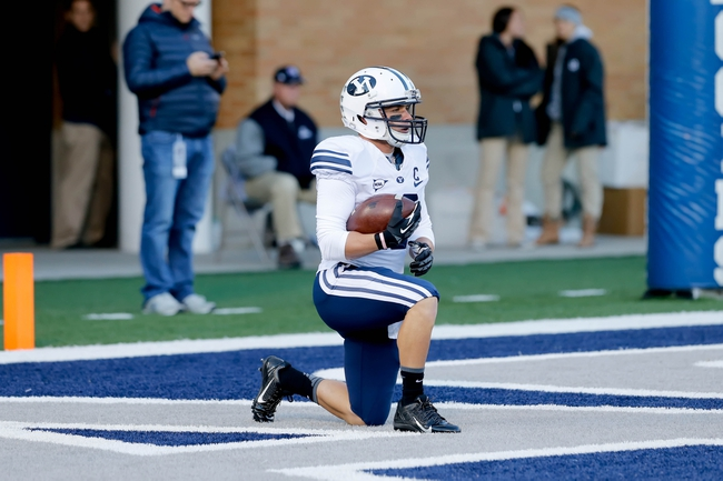Oct 4, 2013; Logan, UT, USA; Brigham Young Cougars wide receiver JD Falslev (12) takes a knee in the end zone after a Utah State Aggies kick-off at Romney Stadium.  Brigham Young Cougars defeated the Utah State Aggies 31-14.  Mandatory Credit: Chris Nicoll-USA TODAY Sports
