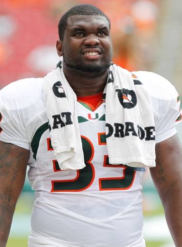 Sep 28, 2013; Tampa, FL, USA; Miami Hurricanes fullback Maurice Hagens (33) against the South Florida Bulls during the second half at Raymond James Stadium. Miami Hurricanes defeated the South Florida Bulls 49-21. Mandatory Credit: Kim Klement-USA TODAY Sports
