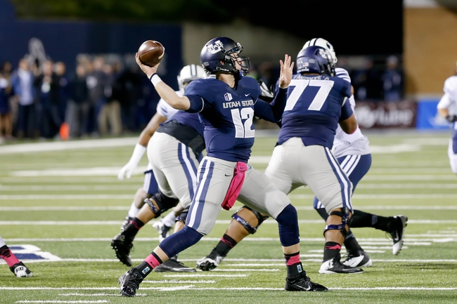 Oct 4, 2013; Logan, UT, USA; Utah State Aggies quarterback Craig Harrison (12) throws the football in the third quarter against the Brigham Young Cougars at Romney Stadium.  Brigham Young Cougars defeated the Utah State Aggies 31-14.  Mandatory Credit: Chris Nicoll-USA TODAY Sports