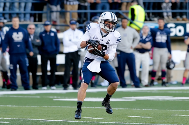 Oct 4, 2013; Logan, UT, USA; Brigham Young Cougars wide receiver JD Falslev (12) catches the ball in the game against the Utah State Aggies at Romney Stadium.  Brigham Young Cougars defeated the Utah State Aggies 31-14.  Mandatory Credit: Chris Nicoll-USA TODAY Sports