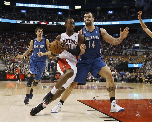Oct 9, 2013; Toronto, Ontario, CAN; Toronto Raptors guard Terrence Ross (31) drives against Minnesota Timberwolves center Nikola Pekovic (14) during the first half at the Air Canada Centre. Mandatory Credit: John E. Sokolowski-USA TODAY Sports
