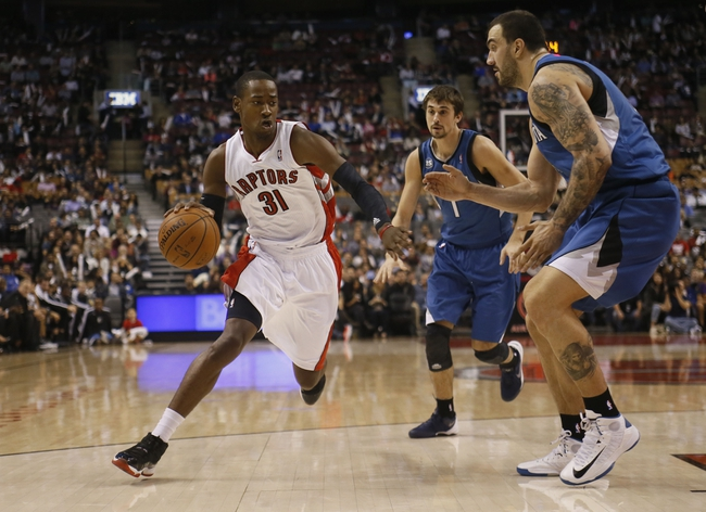 Oct 9, 2013; Toronto, Ontario, CAN; Toronto Raptors guard Terrence Ross (31) drives against Minnesota Timberwolves center Nikola Pekovic (14) and guard Alexey Shved (1) during the first half at the Air Canada Centre. Mandatory Credit: John E. Sokolowski-USA TODAY Sports