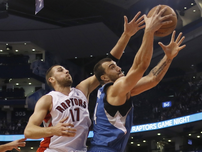 Oct 9, 2013; Toronto, Ontario, CAN; Toronto Raptors center Jonas Valanciunas (17) and Minnesota Timberwolves center Nikola Pekovic (14) go after a rebound during the first half at the Air Canada Centre. Mandatory Credit: John E. Sokolowski-USA TODAY Sports