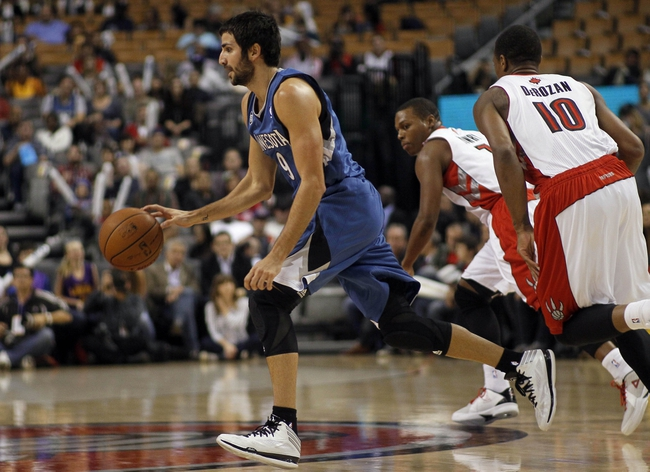 Oct 9, 2013; Toronto, Ontario, CAN; Minnesota Timberwolves guard Ricky Rubio (9) carries the ball against the Toronto Raptors during the first half at the Air Canada Centre. Mandatory Credit: John E. Sokolowski-USA TODAY Sports