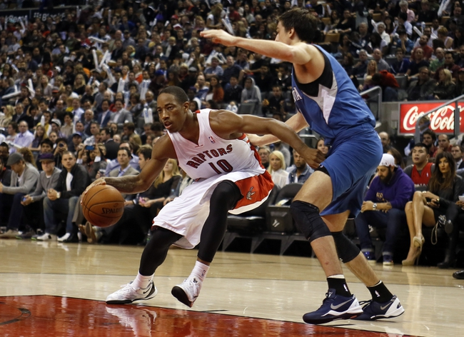 Oct 9, 2013; Toronto, Ontario, CAN; Toronto Raptors guard DeMar DeRozan (10) gets by a Minnesota Timberwolves during the first half at the Air Canada Centre. Mandatory Credit: John E. Sokolowski-USA TODAY Sports