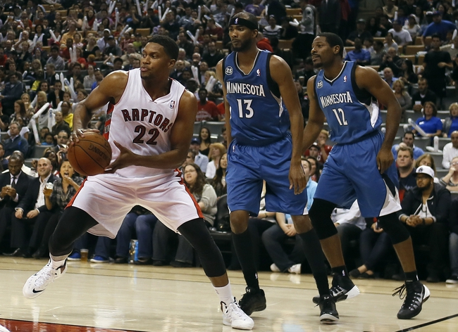 Oct 9, 2013; Toronto, Ontario, CAN; Toronto Raptors forward Rudy Gay (22) gets away from Minnesota Timberwolves forward Corey Brewer (13) and guard Jose Barea (11) during the first half at the Air Canada Centre. Mandatory Credit: John E. Sokolowski-USA TODAY Sports
