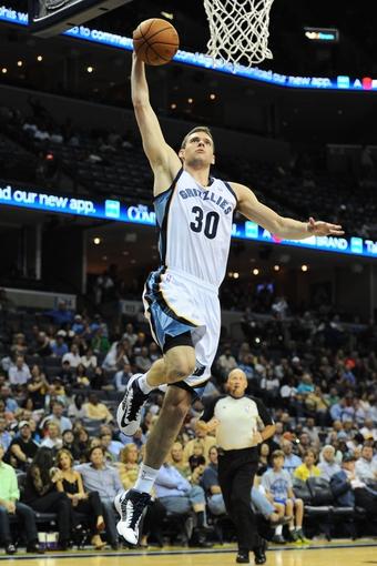 Oct 9, 2013; Memphis, TN, USA; Memphis Grizzlies power forward Jon Leuer (30) dunks the ball against the Dallas Mavericks in the 2nd quarter at FedExForum. Mandatory Credit: Justin Ford-USA TODAY Sports