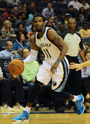 Oct 9, 2013; Memphis, TN, USA; Memphis Grizzlies point guard Mike Conley (11) handles the ball against Dallas Mavericks in the second quarter at FedExForum. Mandatory Credit: Justin Ford-USA TODAY Sports
