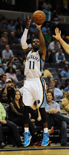 Oct 9, 2013; Memphis, TN, USA; Memphis Grizzlies point guard Mike Conley (11) takes a jump shot against the Dallas Mavericks in the second quarter at FedExForum. Mandatory Credit: Justin Ford-USA TODAY Sports