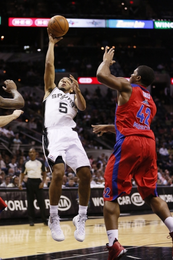 Oct 9, 2013; San Antonio, TX, USA; San Antonio Spurs guard Cory Joseph (5) shoots while being defended by CSKA Moscow center Kyle Hines (42) during the first half at the AT&T Center. Mandatory Credit: Soobum Im-USA TODAY Sports