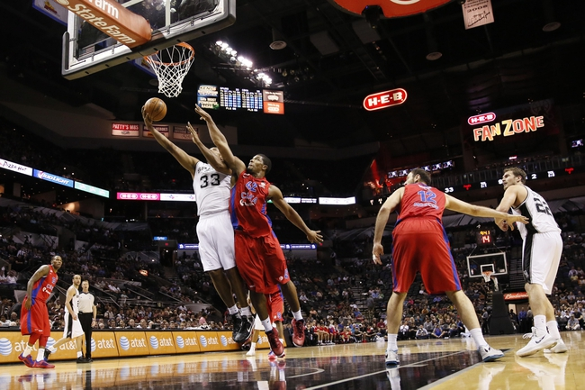 Oct 9, 2013; San Antonio, TX, USA; San Antonio Spurs forward Boris Diaw (33) drives to the basket under pressure from CSKA Moscow center Kyle Hines (42) during the first half at the AT&T Center. Mandatory Credit: Soobum Im-USA TODAY Sports