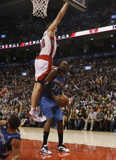 Oct 9, 2013; Toronto, Ontario, CAN; Minnesota Timberwolves center Ronny Turiaf (32) grimaces as Toronto Raptors forward Tyler Hansbrough (50) goes high to block at the Air Canada Centre. Minnesota defeated Toronto 101-89. Mandatory Credit: John E. Sokolowski-USA TODAY Sports