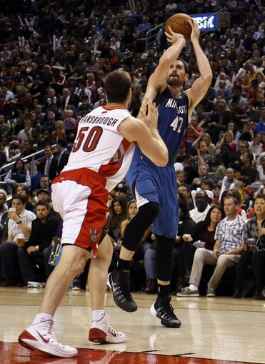 Oct 9, 2013; Toronto, Ontario, CAN; Minnesota Timberwolves forward-center Kevin Love (42) goes to shoot as Toronto Raptors forward Tyler Hansbrough (50) defends at the Air Canada Centre. Minnesota defeated Toronto 101-89. Mandatory Credit: John E. Sokolowski-USA TODAY Sports