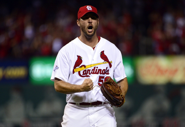 Oct 9, 2013; St. Louis, MO, USA; St. Louis Cardinals starting pitcher Adam Wainwright (50) reacts after getting out of the sixth inning against the Pittsburgh Pirates in game five of the National League divisional series playoff baseball game at Busch Stadium. Mandatory Credit: Scott Rovak-USA TODAY Sports