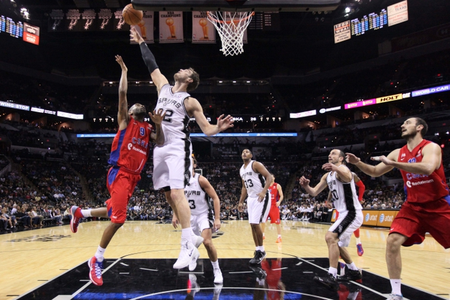Oct 9, 2013; San Antonio, TX, USA; CSKA Moscow guard Aaron Jackson, (9) drives to the basket while defended by San Antonio Spurs forward Tiago Splitter (22) during the first half at the AT&T Center. Mandatory Credit: Soobum Im-USA TODAY Sports