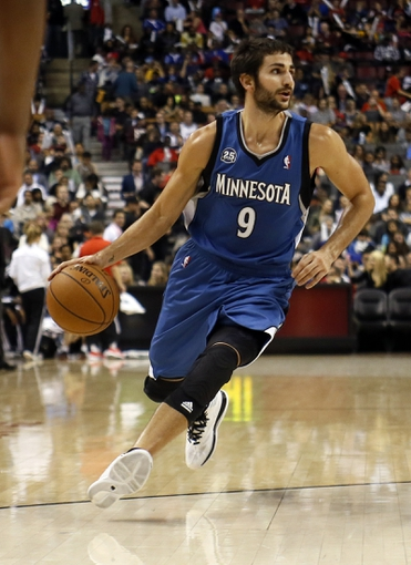 Oct 9, 2013; Toronto, Ontario, CAN; Minnesota Timberwolves guard Ricky Rubio (9) carries the ball against the Toronto Raptors at the Air Canada Centre. Minnesota defeated Toronto 101-89. Mandatory Credit: John E. Sokolowski-USA TODAY Sports