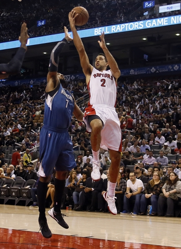 Oct 9, 2013; Toronto, Ontario, CAN; Toronto Raptors guard Landry Fields (2) goes up for a lay up as Minnesota Timberwolves forward Derrick Williams (7) defends at the Air Canada Centre. Minnesota defeated Toronto 101-89. Mandatory Credit: John E. Sokolowski-USA TODAY Sports